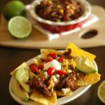 Crockpot Chipotle Beef Nachos with Roasted Corn and Tomatoes