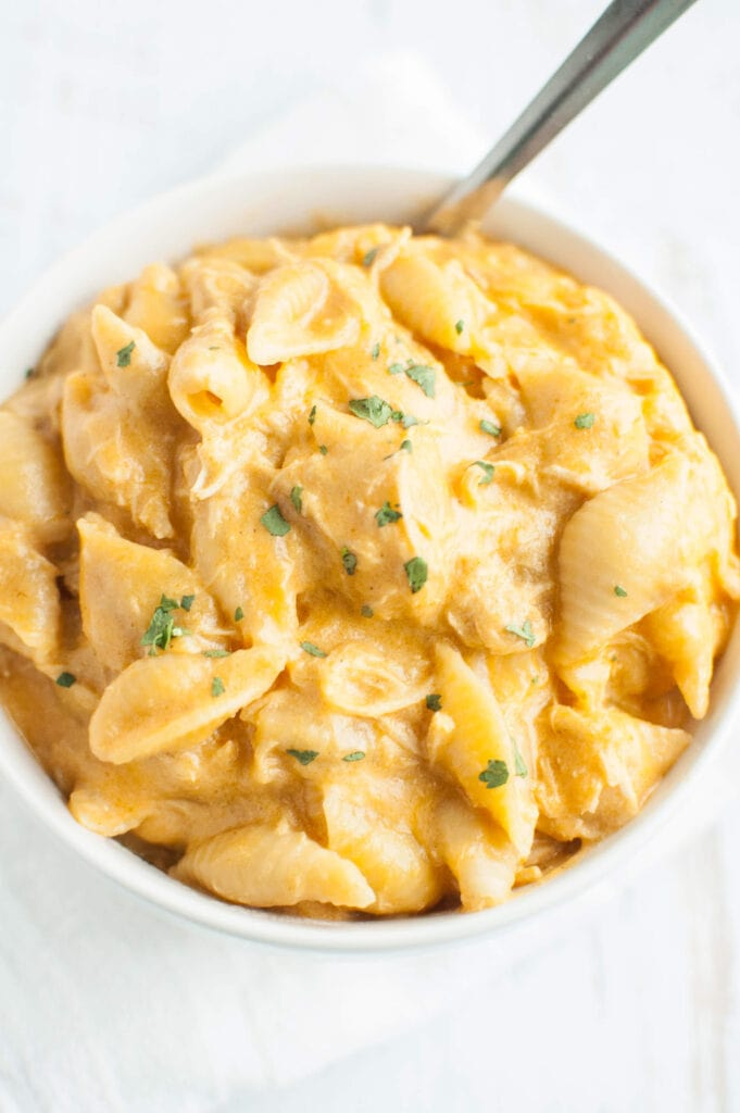 Slow Cooker Buffalo Chicken Mac and Cheese in a white bowl topped with parsley