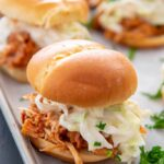 Slow Cooker BBQ Pulled Chicken on Hawaiian slider bun topped with coleslaw