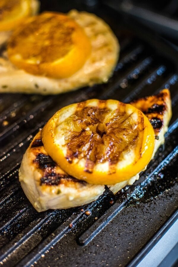 Mustard Citrus Chicken on the grill topped with oranges