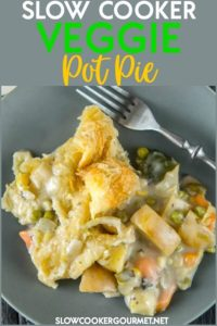 This easy Slow Cooker Veggie Pot Pie recipe is full of tender veggies cooked all day in the slow cooker and the most delicious homemade creamy sauce.  Top it off with a simple puff pastry for an amazing weeknight dinner sure to impress! #slowcooker #veggie #potpie