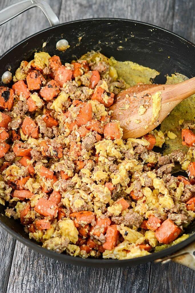 Browning meat in a skillet - Slow Cooker Breakfast Enchiladas