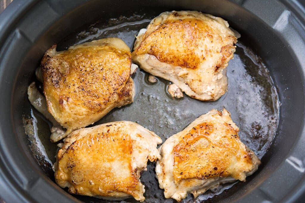 Chicken Thighs browning in the slow cooker - Slow Cooker Balsamic Chicken with Carrots