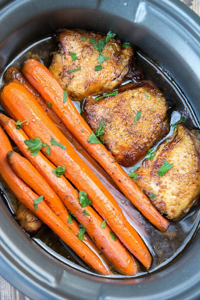 Slow Cooker Balsamic Chicken with Carrots in a black crock.