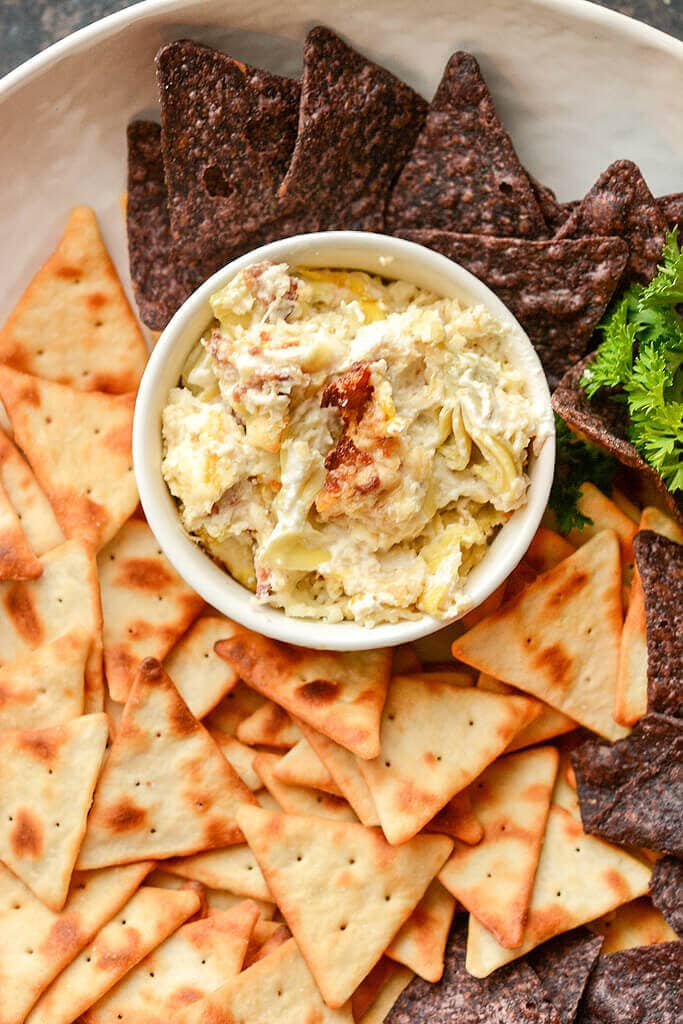 Slow cooker artichoke dip with pita chips.