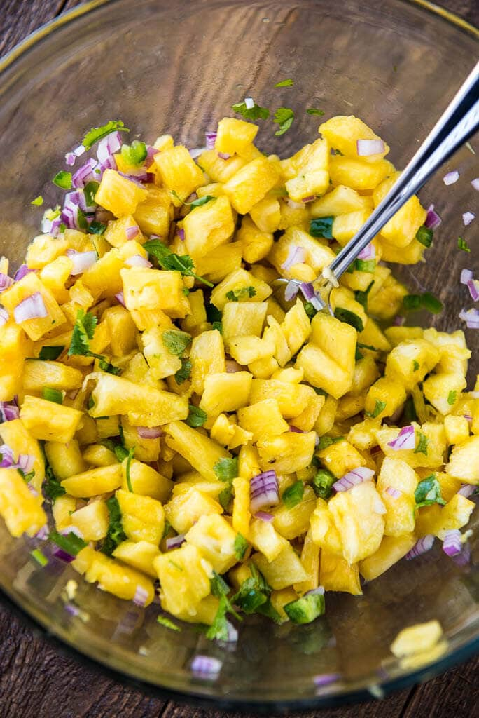 Bowl of pineapple salsa ready to top Pressure Cooker Pulled Pork