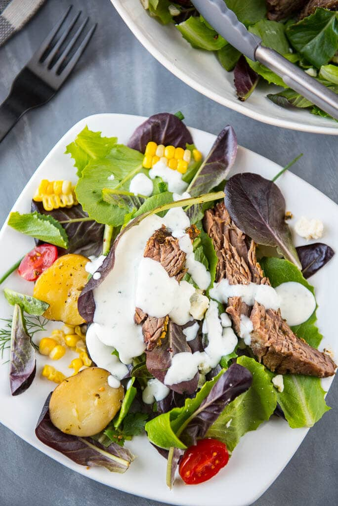 Slow Cooker Hearty Steak Salad is a simple and fresh meal that makes it easy to eat healthy even on busy summer nights!