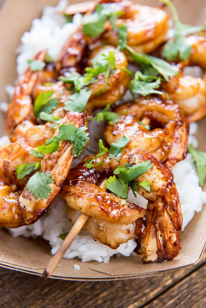 The perfect summer meal! With a slightly spicy sauce these Raspberry Chipotle Shrimp can be cooked on the grill or in your favorite pan for a quick weeknight meal.