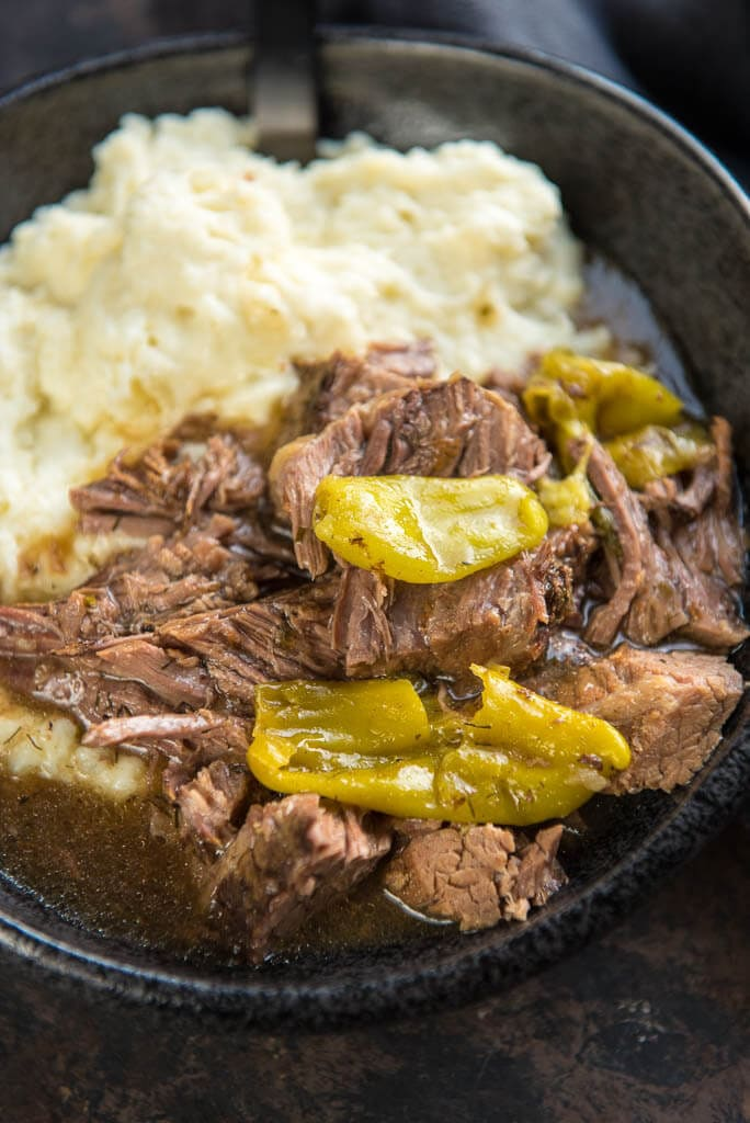 Slow Cooker Mississippi Pot Roast is a simple way to take your dinner from average to amazing! Mezzetta Pepperoncini Peppers give a tasty twist to roast beef for the ultimate family meal.