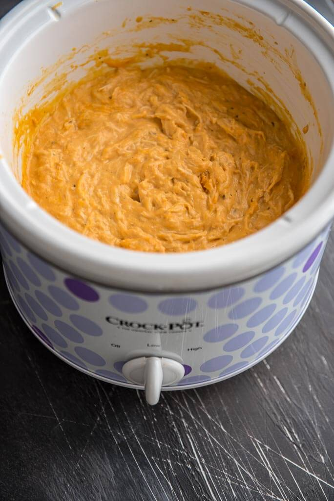 Cheesy Slow Cooker Buffalo Chicken Dip in purple polka dot slow cooker