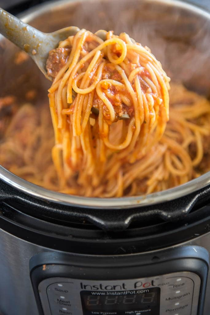 A spoonful of Veggie Packed Instant Pot Spaghetti with Meat Sauce from the Instant Pot
