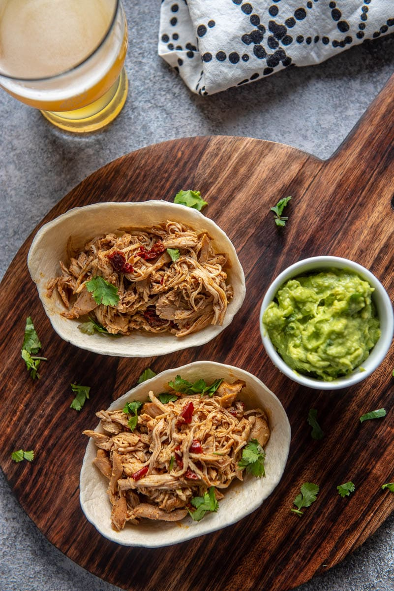chicken taco boats on wood cutting board with guacamole