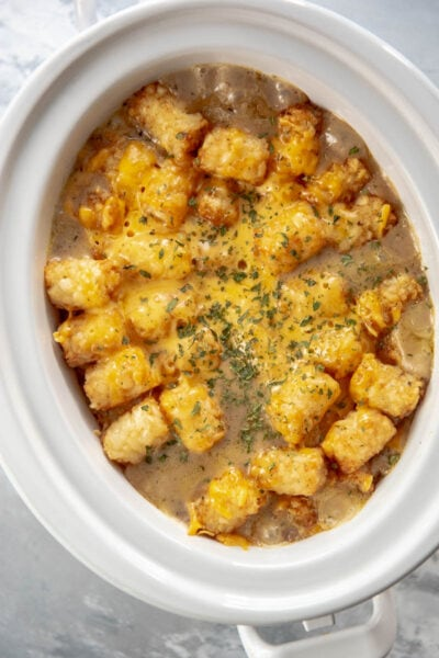 tater tot casserole in oval casserole slow cooker