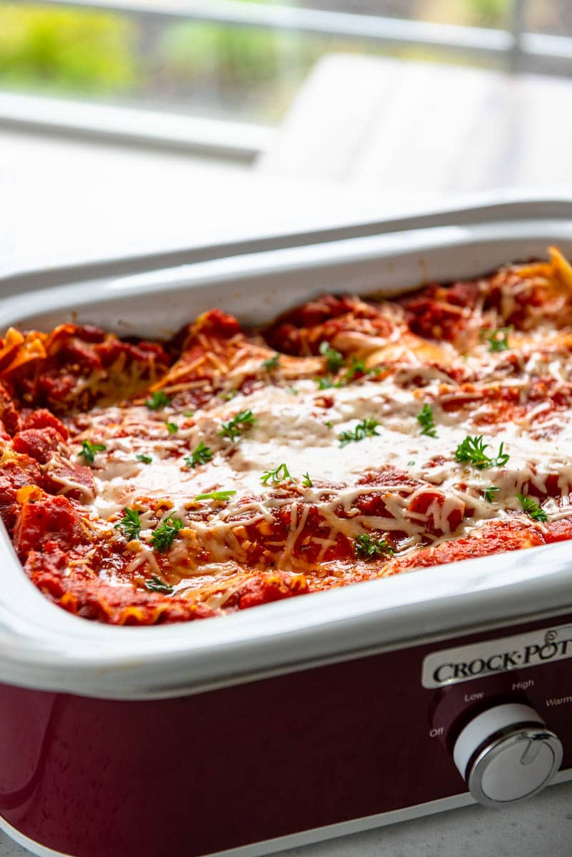 casserole slow cooker on counter with lasagna