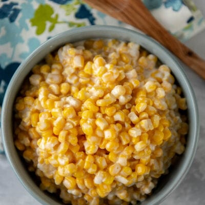 blue bowl filled with creamed corn