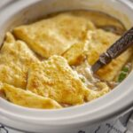 turkey pot pie in blue and white casserole slow cooker