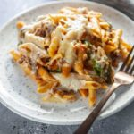 serving of pasta bake with penne pasta and cheese on plate