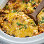 taco casserole with wooden spoon in oval mini casserole slow cooker