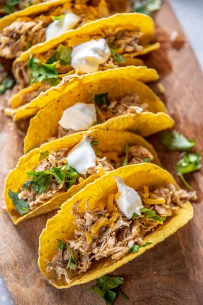 chicken verde tacos on a wood plank