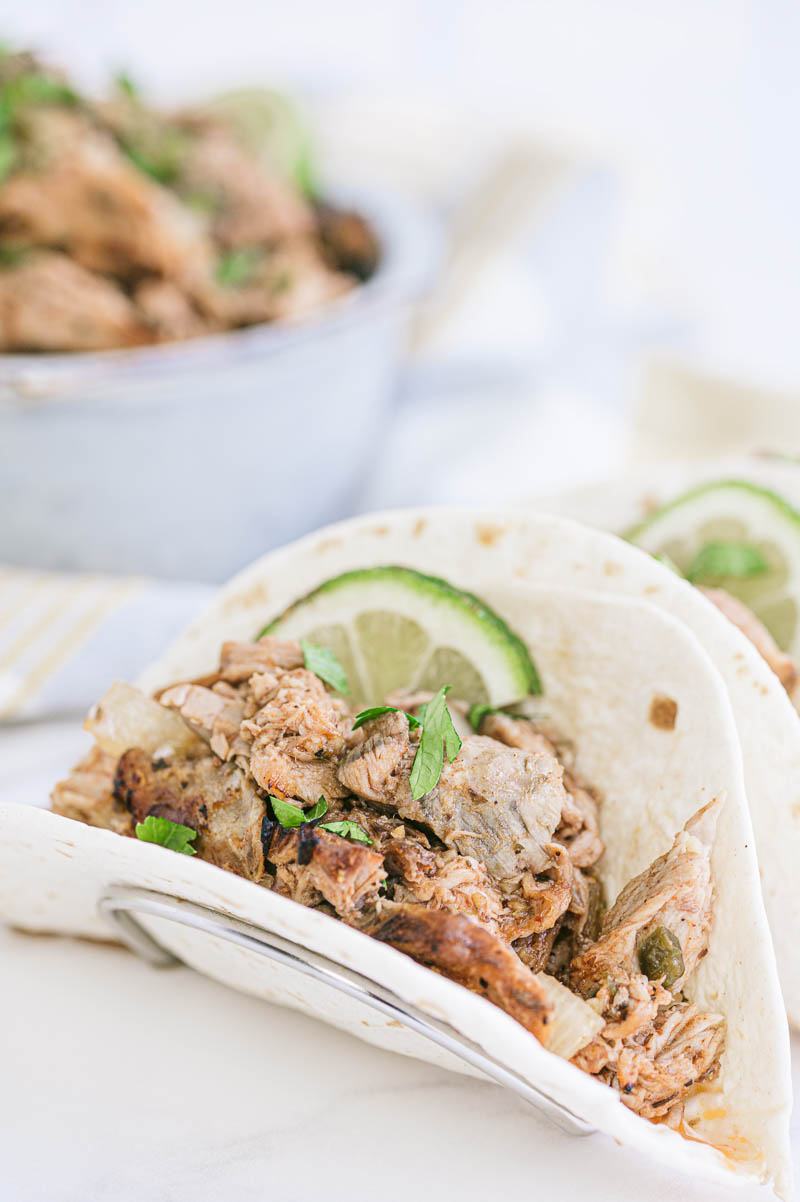 carnitas with lime on a plate