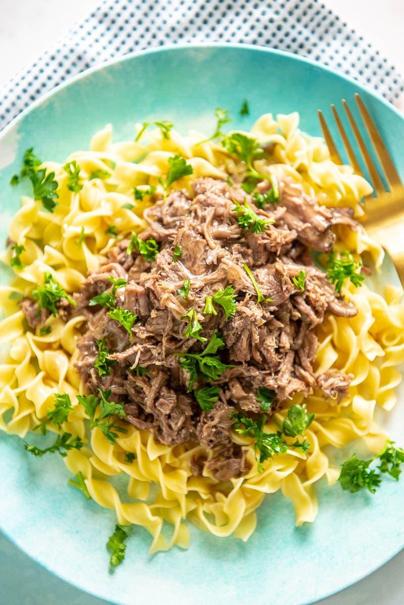 shredded beef over noodles