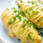 two honey mustard chicken breasts on a plate